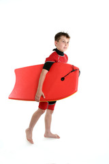 surfer boy holding a bodyboard