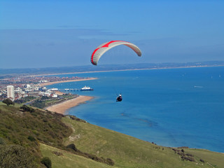 paraglider flying over beachy head