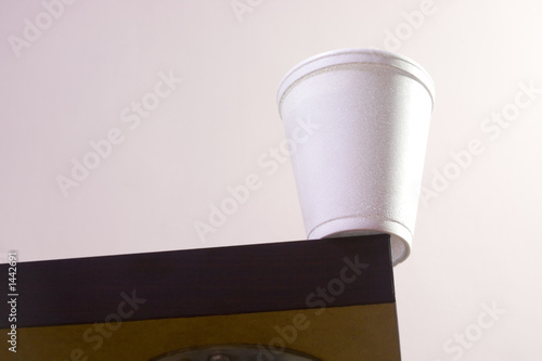 cup on table edge