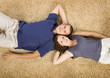 young couple on beige carpet