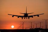 Fototapety sunset jet landing 3