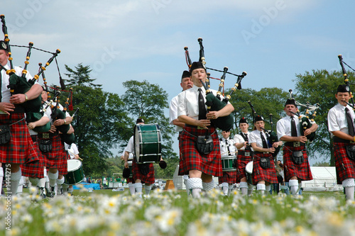 scottish band marching on grass