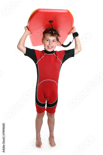 poster of child carrying a surfboard