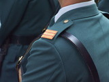 uniforme y correaje poster