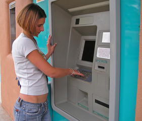 girl at an atm machine