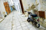 motorcycle at arabian street in medina poster