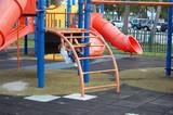 little boy on a playground ladder poster