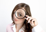 young woman with magnifying glass poster