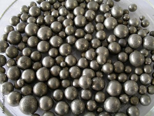 nickel ball bearings in dish in science lab - 1459231