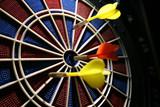 dart boart with three darts poster