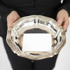 blanco business card on a silver plate