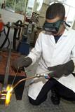 student welding poster