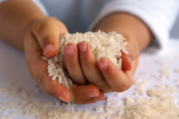 hands with rice