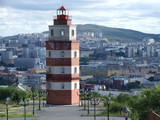 lighthouse and murmansk city panorama poster