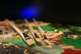 three paint brushes on pallette poster