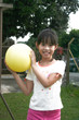 girl holding yellow ball