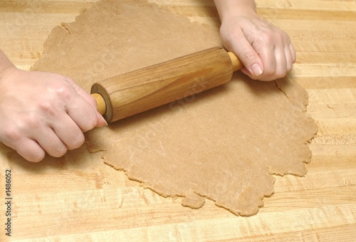rolling out a pie crust