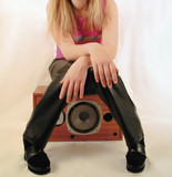 young girl sitting on speaker poster