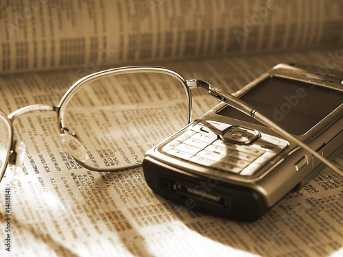 mobile phone and glasses on phone directory