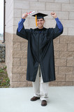 man celebrating graduation poster