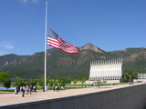 flag lowered to half staff . poster