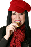 female eating healthy nut bar poster