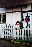 christmas decorations on gate half timbered cottag poster