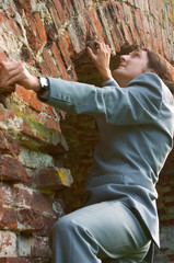 businessman climbing the wall