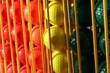 miniature golf balls in a rack poster