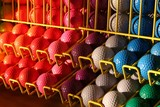 miniature golf balls in a rack
