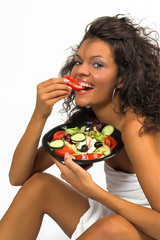 beautiful brunette girl eating fresh salad