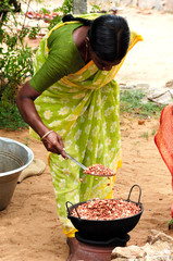 india: roasting peanuts in the street