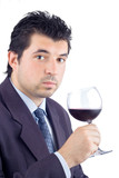 man in a suit tasting wine poster