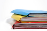 stack of colorful binders in a office poster