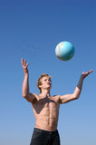 young muscular man playing with a globe poster