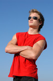 muscular young man in red poster