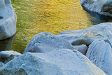 river reflections and boulders poster