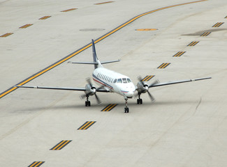 small turboprop airplane on runway