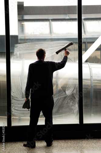 cleaning the windows at the airport