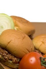 sloppy joe sandwich with tomatoes onions