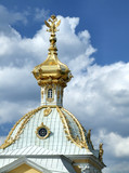 golden dome with a sculpture poster