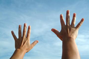 open hands on sky