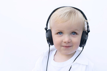 happy young boy wearing headphones