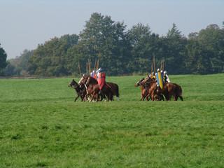norman knights crossing filed of battle on horseba