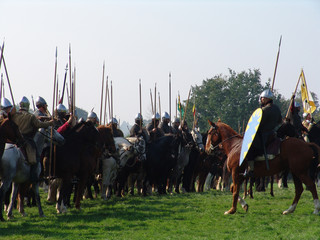 knights on horseback lined up for battle charge