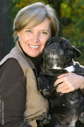 woman holds a dog