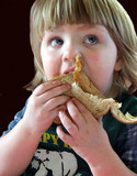 child eating a sandwich poster