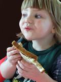 girl eating a peanut butter sandwich poster