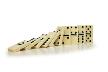 domino effect - dominos isolated on white