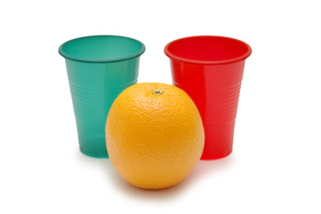 two plastic cups and orange
